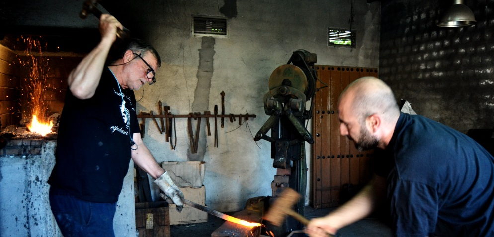 Antonio Arellano and his son forge a handcraft blade from Toledo